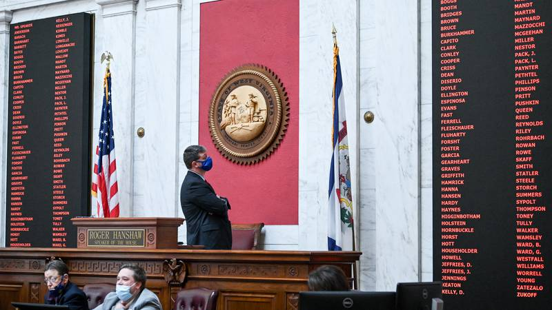 House Speaker Roger Hanshaw looks at the chamber's voting board as members unanimously reject...