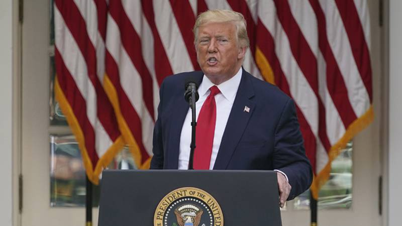 President Donald Trump answers questions from reporters during an event on protecting seniors...
