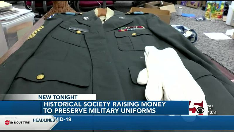 Preserving military uniforms for future display