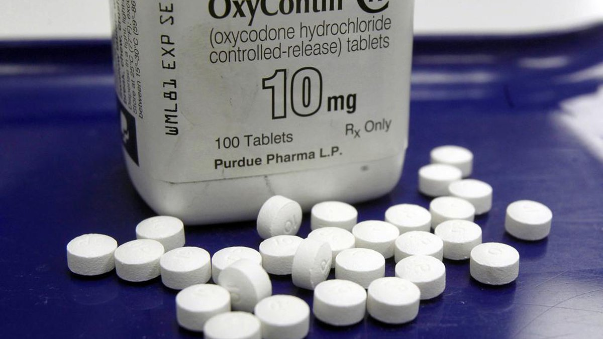 This Feb. 19, 2013, file photo shows OxyContin pills arranged for a photo at a pharmacy in...