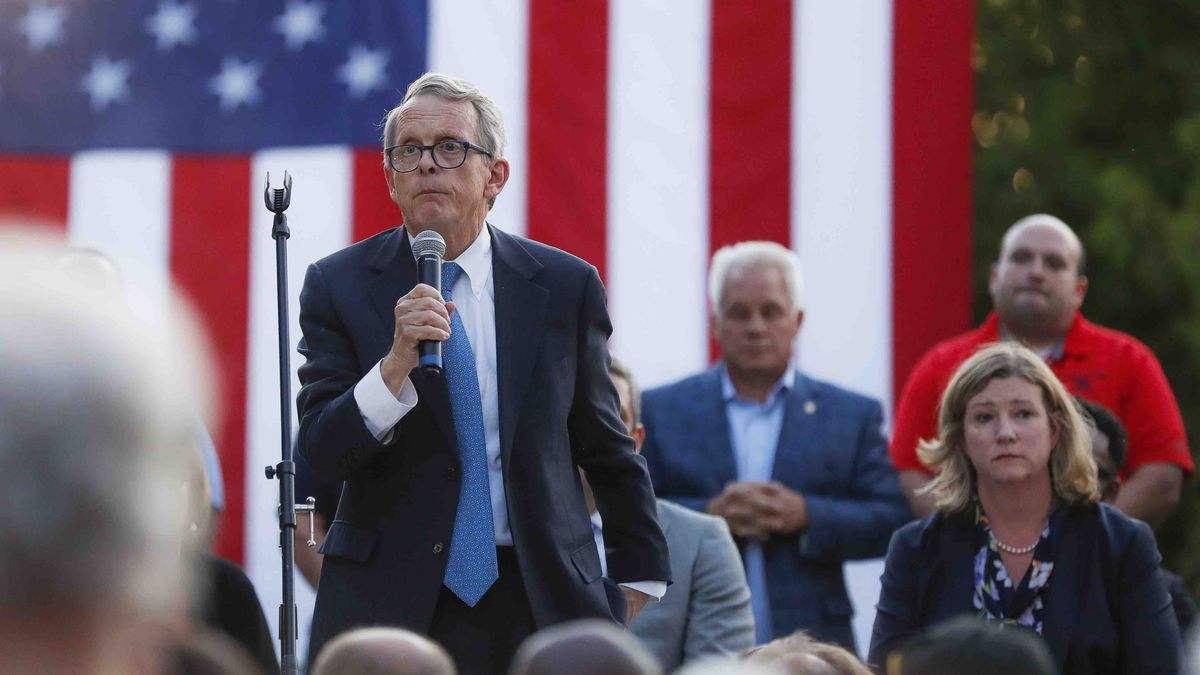Ohio Gov. Mike DeWine, left, speaks alongside Dayton Mayor Nan Whaley, right, during a vigil at the scene of a mass shooting, Sunday, Aug. 4, 2019, in Dayton, Ohio. Multiple people in Ohio have been killed in the second mass shooting in the U.S. in less than 24 hours, and the suspected shooter is also deceased, police said. (AP Photo/John Minchillo)
