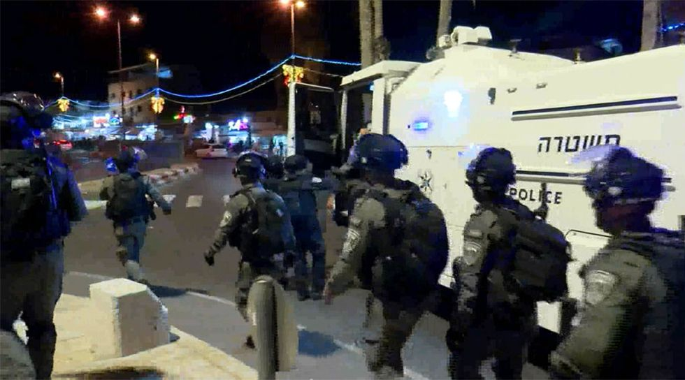 Israeli police in riot gear clashed with Palestinians following evening prayers at at...