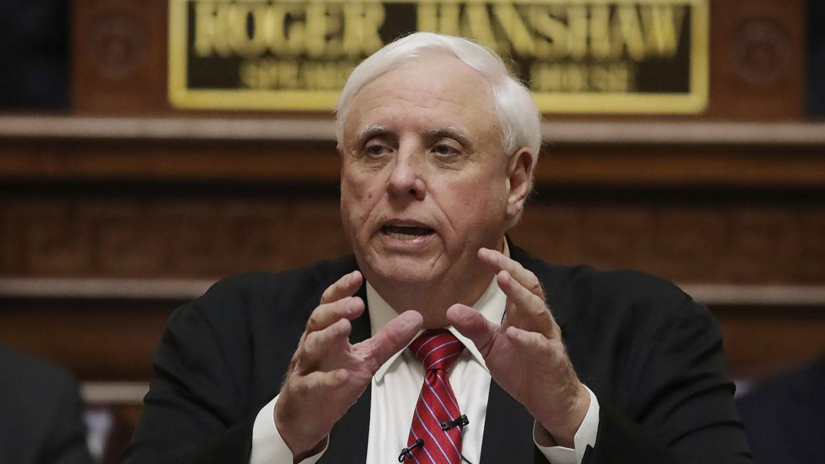 FILE - In this Jan. 8, 2020, file photo, West Virginia Gov. Jim Justice delivers his annual State of the State address in the House Chambers at the state capitol in Charleston, W.Va. The former West Virginia public health leader forced out by the governor says decades-old computer systems and cuts to staff over a period of years had made a challenging job even harder during a once-in-a-century pandemic. Republican Gov. Jim Justice demanded Dr. Cathy Slemp's resignation on June 24. (AP Photo/Chris Jackson, File)