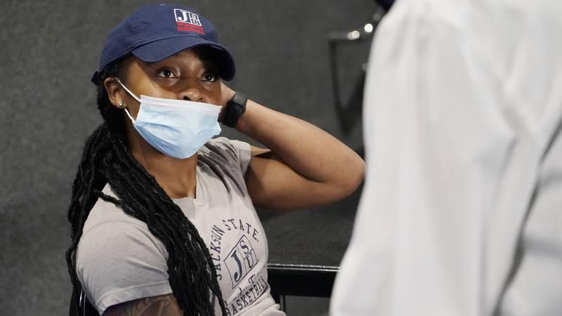 Jniya Tallie, a graduate assistant with the Jackson State women's basketball team, left, speaks...