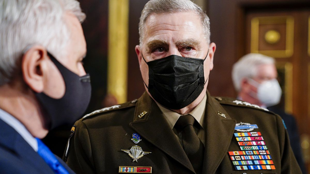 Joint Chiefs Chairman Gen. Mark Milley arrives to the chamber ahead of President Joe Biden...