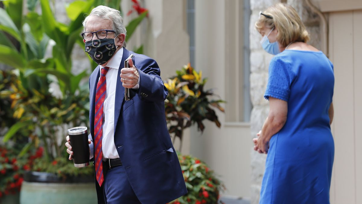 Ohio Governor Mike DeWine, left, and his wife Fran, walk into their residence after he tested positive for COVID-19 earlier in the day Thursday, Aug. 6, 2020, in Bexley, Ohio.