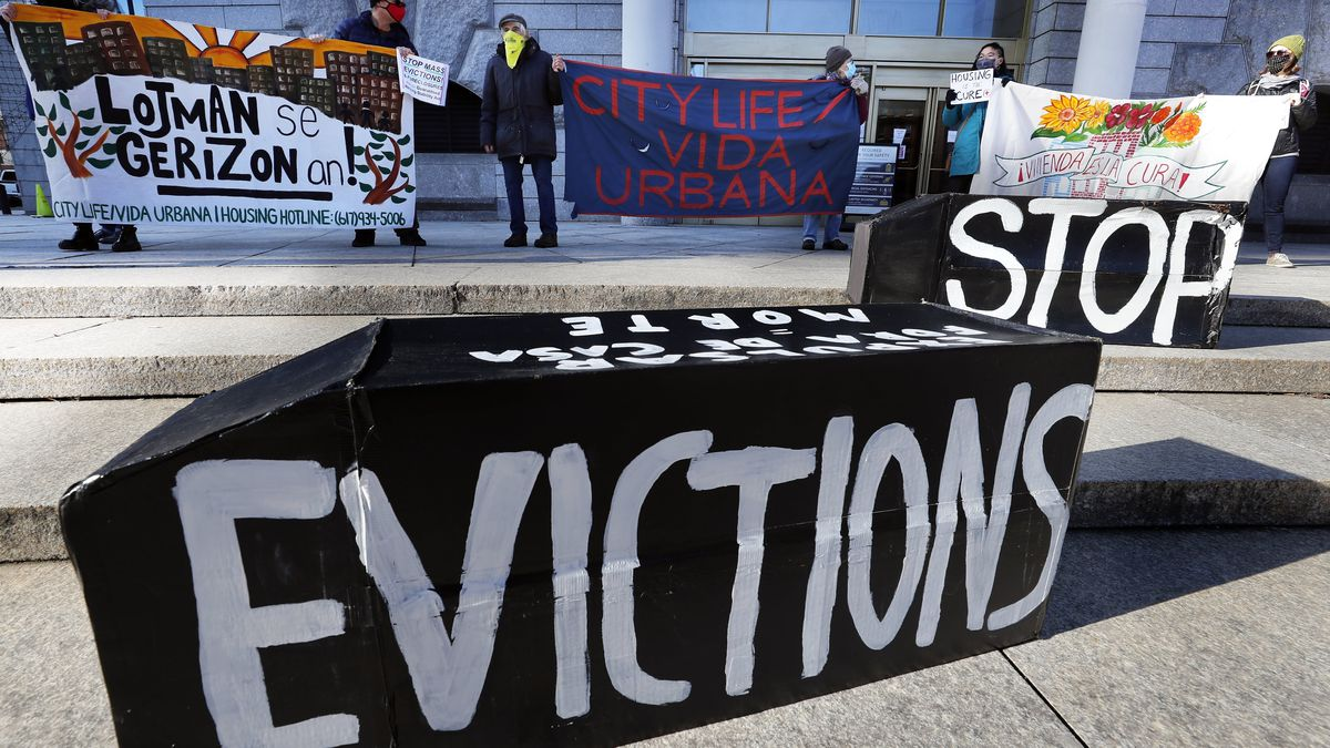 FILE - In this Jan. 13, 2021, file photo, demonstrators hold signs in front of the Edward W....