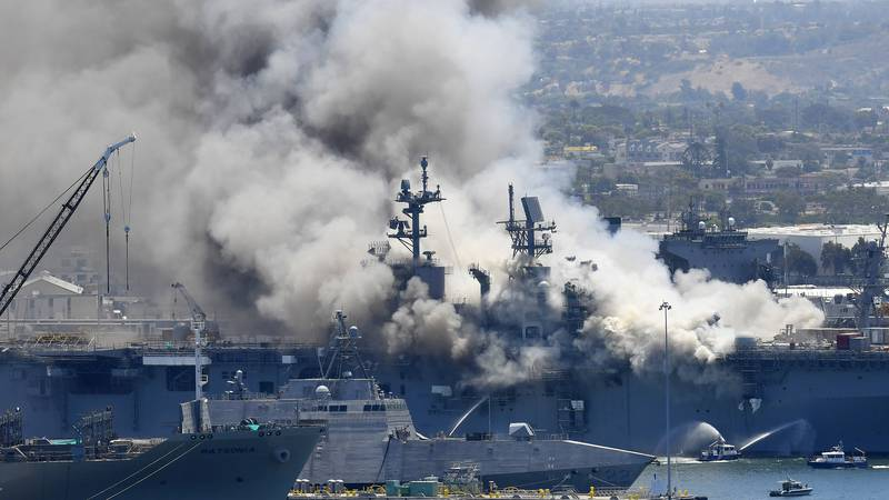 FILE - In this July 12, 2020, file photo, smoke rises from the USS Bonhomme Richard in San...