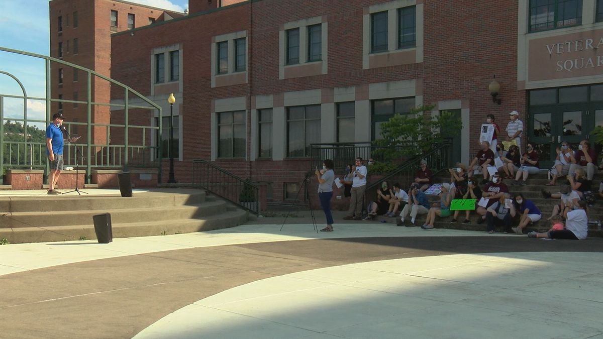 The Falcons for the Arts group holds a rally in support of the music and theater programs at...