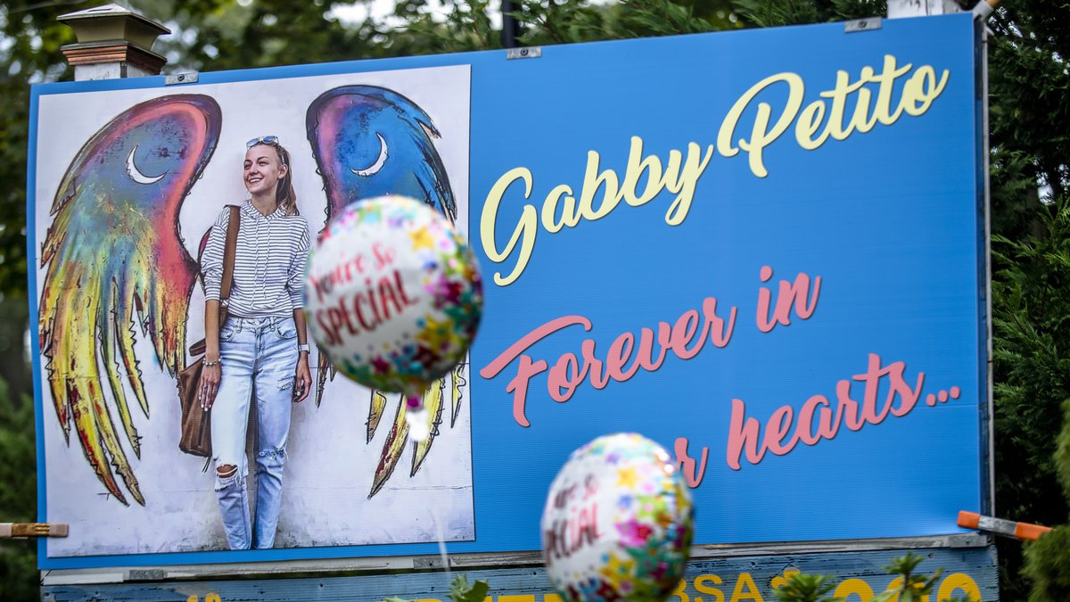 FILE - Memorials for Gabby Petito are scattered across her hometown of Blue Point, New York, on...