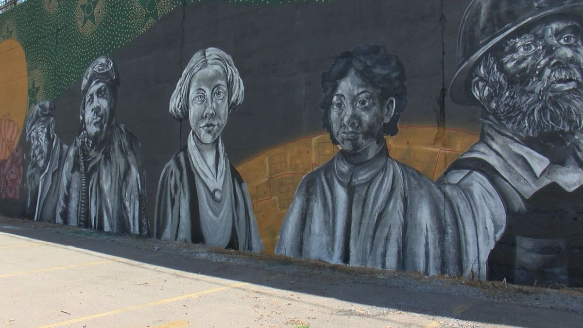 The mural took ten days to complete. It features five historic figures from Marion County.