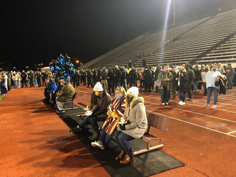 A prayer vigil Wednesday night at Laidley Field honored the life and service of Charleston...