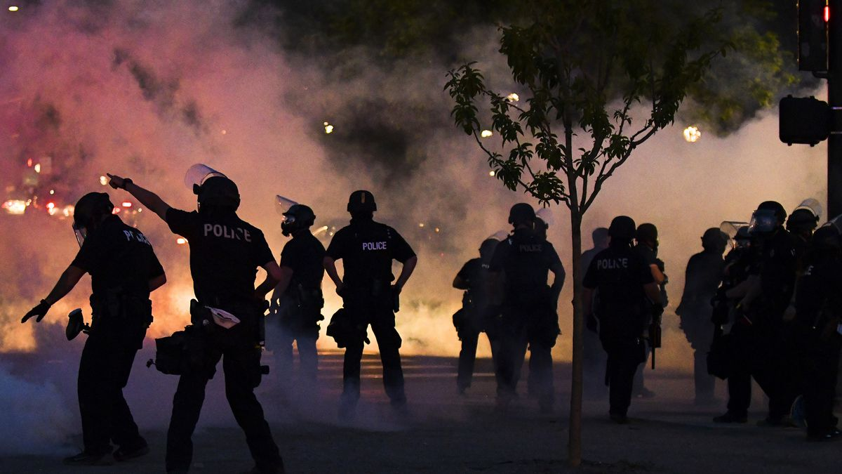 DENVER, CO - MAY 29: Police officers fire tear gas at protesters near the Colorado state capitol during a protest on May 29, 2020 in Denver, Colorado. This was the second day of protests in Denver, with more demonstrations planned for the weekend. Demonstrations are being held across the US after George Floyd died in police custody on May 25th in Minneapolis, Minnesota.(Photo by Michael Ciaglo/Getty Images)