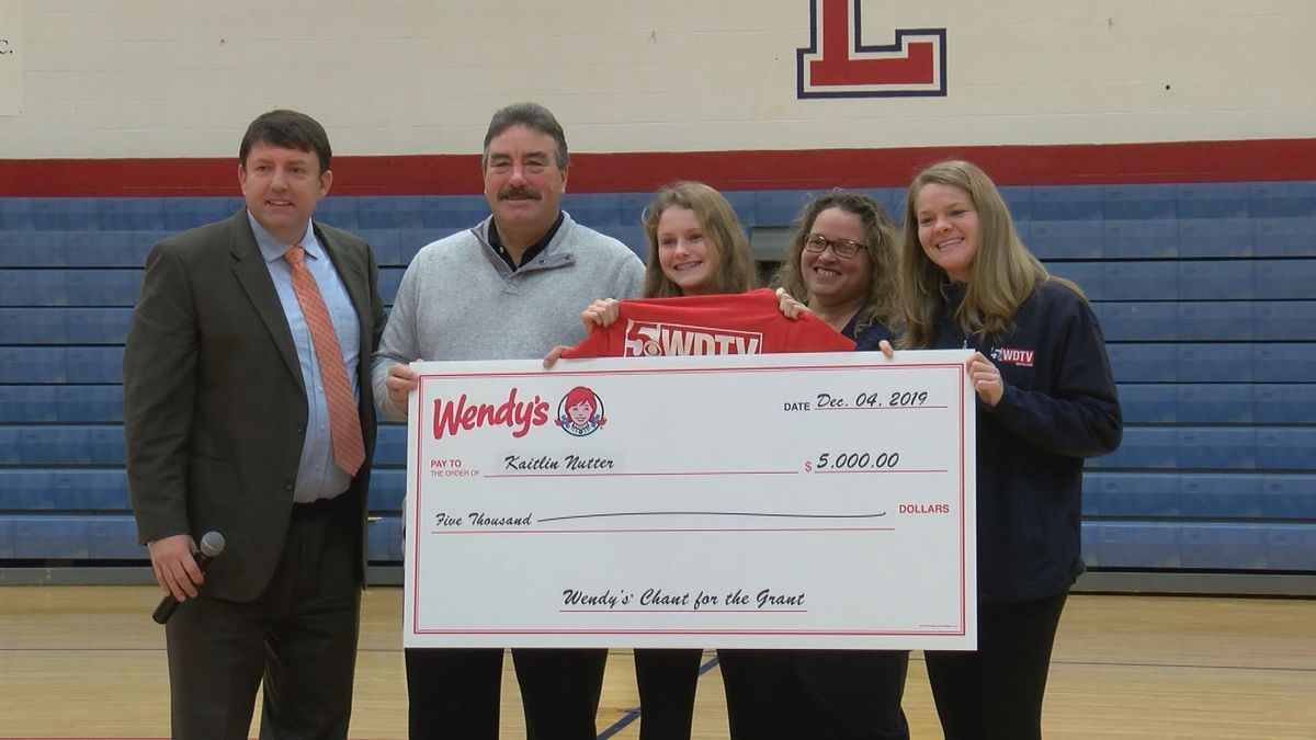 "Kaitlin Nutter announced as ""Chant for the Grant"" winner and received a $5,000 check."