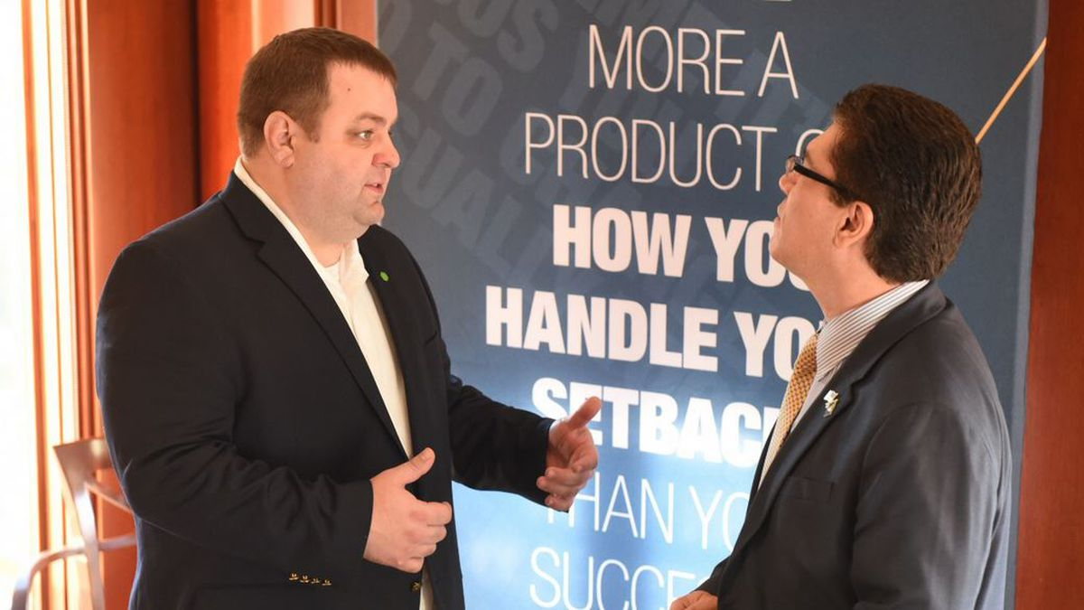 Huntington's regional president for West Virginia, left, talks with Javier Reyes, dean of the WVU John Chambers College of Business and Economics. Huntington presented a gift of $2 million to the business school on Dec. 18 for its Startup Engine business accelerator.  Courtesy: WVU Today