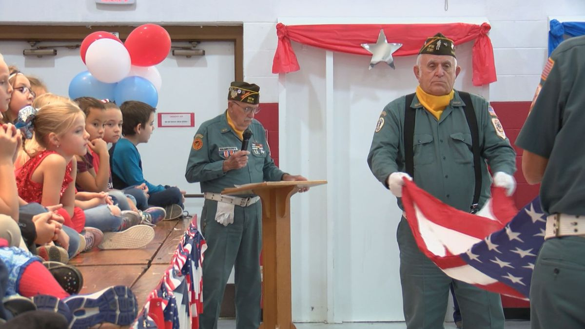 Students were shown how to properly fold the American flag at the assembly.