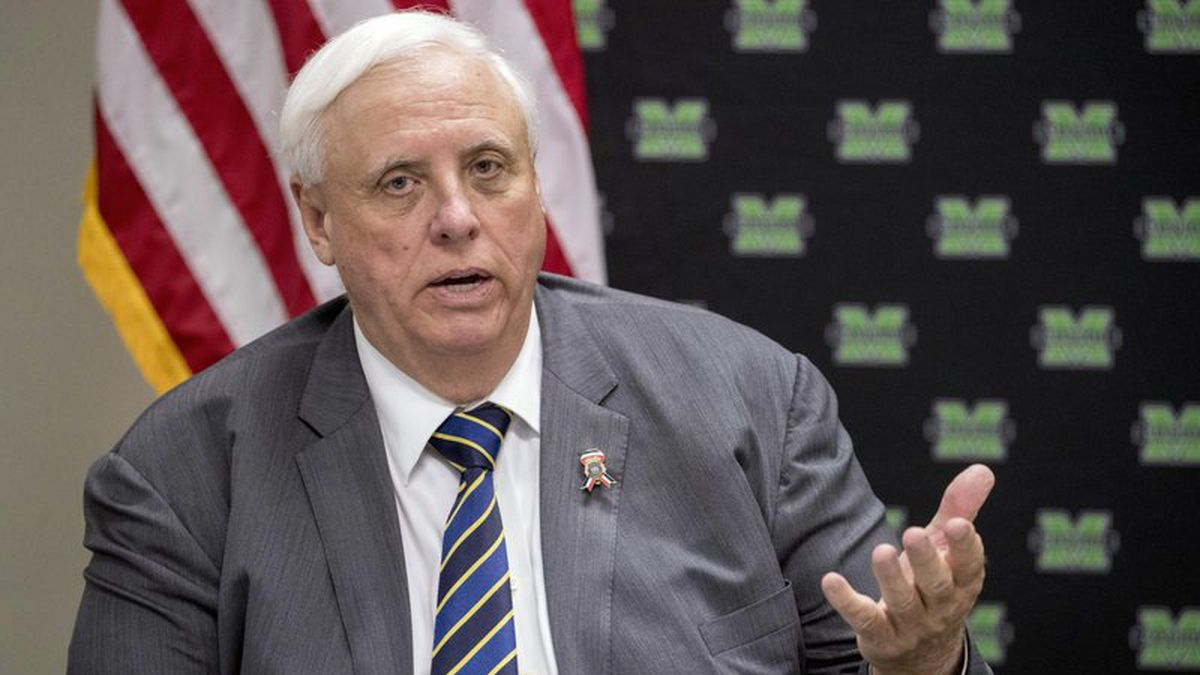 FILE - In this July 8, 2019, file photo, West Virginia Gov. Jim Justice speaks at a roundtable in Huntington, W.Va. West Virginia lawmakers are making quick work of their second special session after legislators say Justice sprung a series of bills on them with little warning. The House of Delegates and Senate on Monday, Nov. 18 approved a measure to stop expunging DUI convictions and passed a bill allowing the state to pay off a road bond. (AP Photo/Andrew Harnik, File)