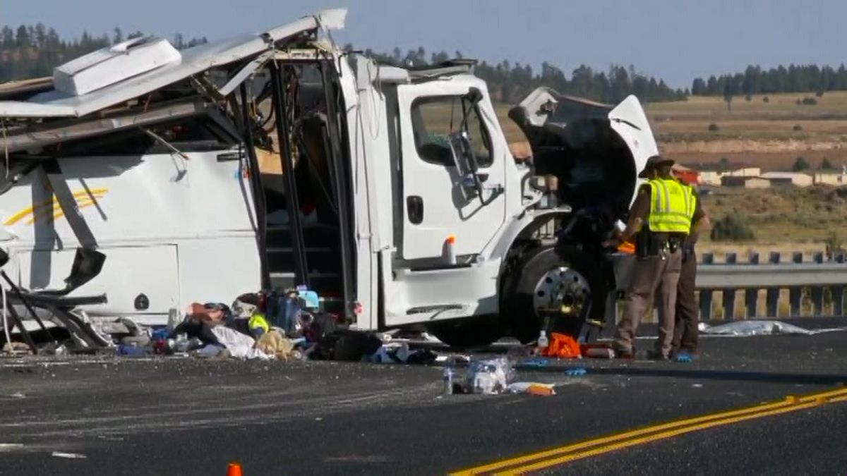 Authorities work the scene where at least four people were killed in a tour bus crash near Bryce Canyon National Park in Utah. (Source: KSTU via CNN)
