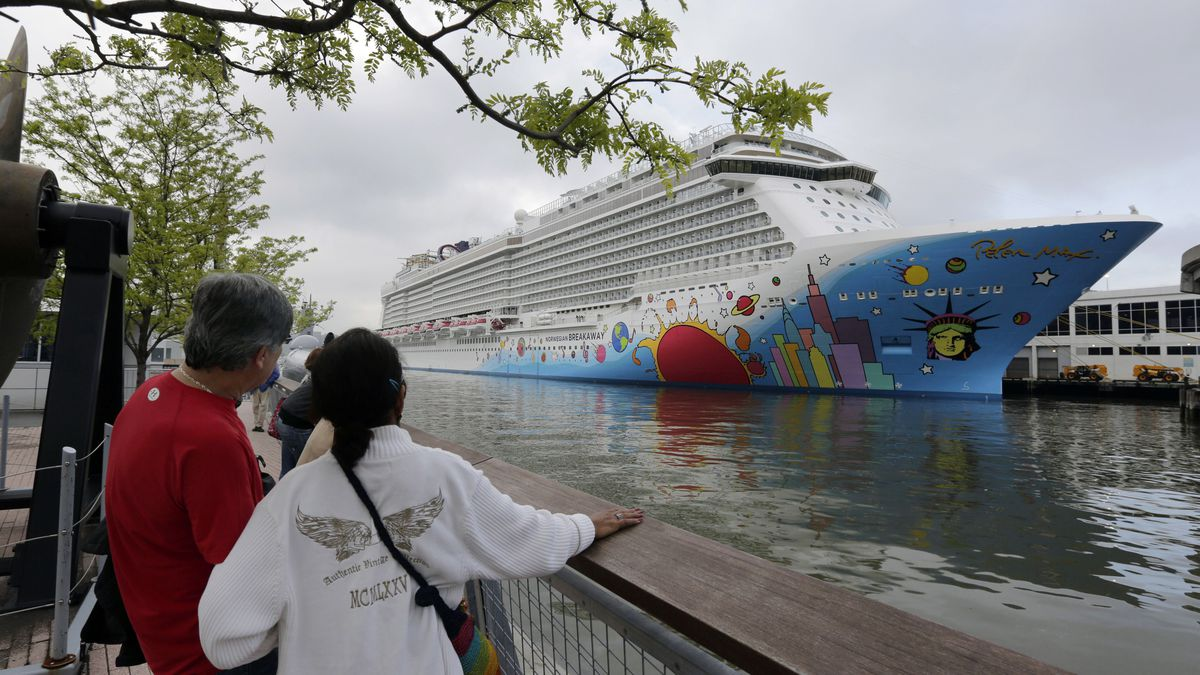 FILE - In this May 8, 2013, file photo, people pause to look at Norwegian Cruise Line's ship,...