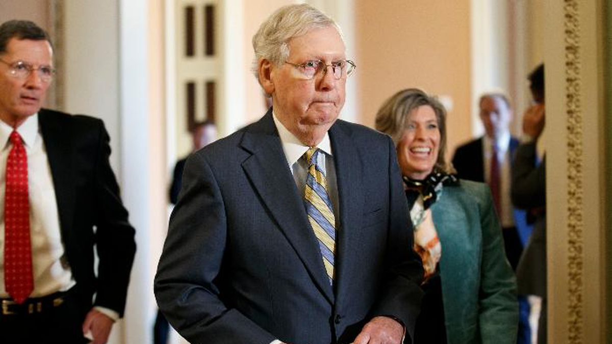 In this Oct. 29, 2019, photo, Senate Majority Leader Mitch McConnell of Ky., center, walks to the podium with Sen. John Barrasso, R-Wyo., left, and Sen. Joni Ernst, R-Iowa, Tuesday, Oct. 29, 2019, on Capitol Hill in Washington. A bitter fight over funding for border fencing is imperiling Capitol Hill efforts to forge progress on more than $1.4 trillion worth of overdue spending bills. (AP Photo/Jacquelyn Martin)