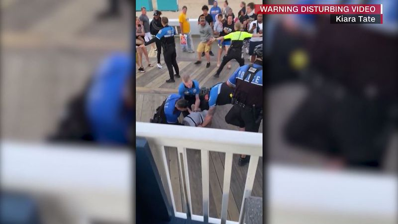 Brian Anderson, a Black 19-year-old, is seen in video being kneed by one officer while others...