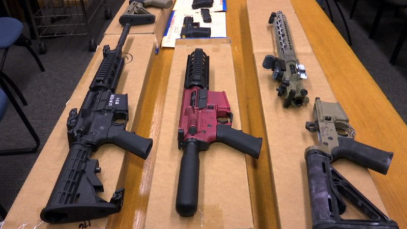"FILE - This Nov. 27, 2019, file photo shows ""ghost guns"" on display at the headquarters of the..."