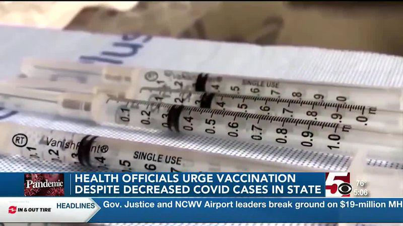 Health officials urge vaccination despite decreased covid cases in state.