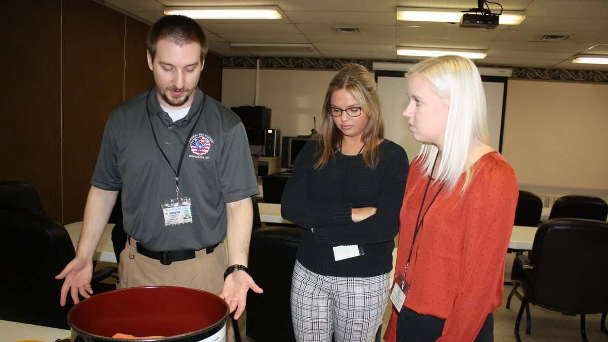 WVU School of Public Health students Jessica Messenger and Marloes Zieren learn about radiation detection and personal protective equipment from Joe Klass, MCHD threat preparedness specialist. (Photo courtesy of the Monongalia County Health Department)
