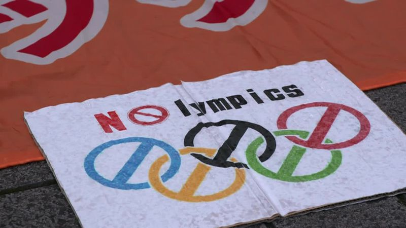 People protest in Tokyo against the Olympic Games.