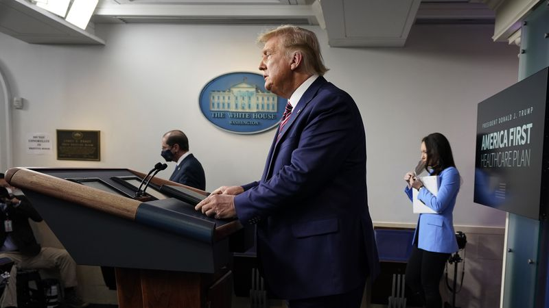 President Donald Trump arrives to speak at a news conference in the briefing room at the White...