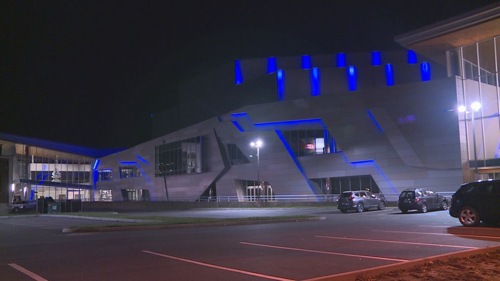 The Charleston Coliseum Convention Center was lit up blue Wednesday night to honor Officer...