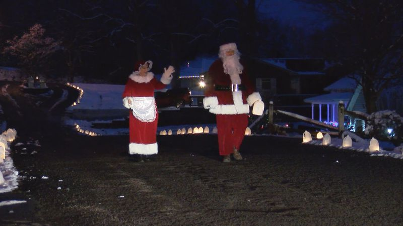 Even the Clauses had to see the lights in Marion County.