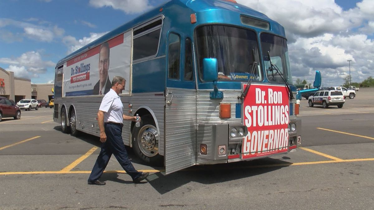 Dr. Ron Stollings, a Democratic candidate for governor, boards his campaign bus after stopping in Bridgeport on Friday.